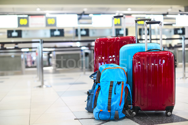 Stack of travelers luggage in airport terminal Stock photo © dashapetrenko