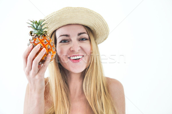 Pretty young woman in swimsuit and straw hat holding fresh pinea Stock photo © dashapetrenko