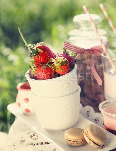 Picnic with strawberry, cookies, strawberry milk, jelly and maca Stock photo © dashapetrenko