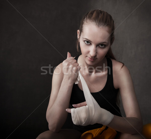 Woman boxer wearing white strap on wrist Stock photo © dashapetrenko