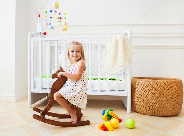 Kicsi aranyos lány faiskola szoba kosár Stock fotó © dashapetrenko