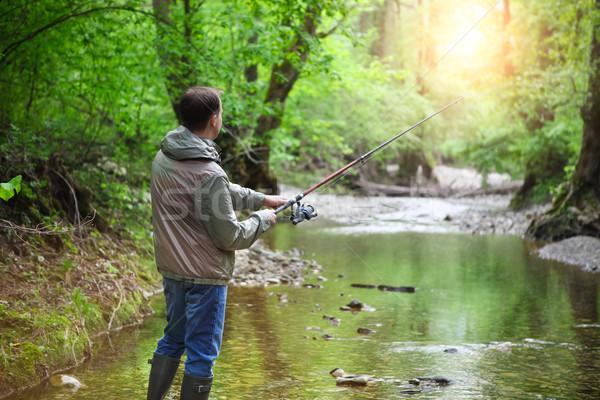 Pescador montanha rio primavera tempo peixe Foto stock © dashapetrenko