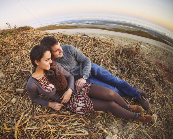Happy young couple lying down smiling at autumn background Stock photo © dashapetrenko