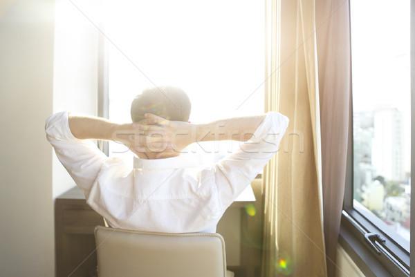 Homem relaxante cadeira quarto quarto de hotel Foto stock © dashapetrenko