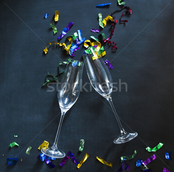 Two champagne glasses on black background Stock photo © dashapetrenko