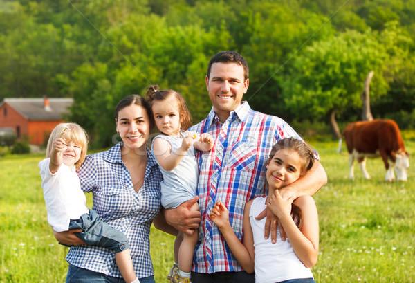 Young family with three children on the farm Stock photo © dashapetrenko