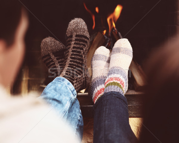 Romantikus lábak pár zokni kandalló közelkép Stock fotó © dashapetrenko