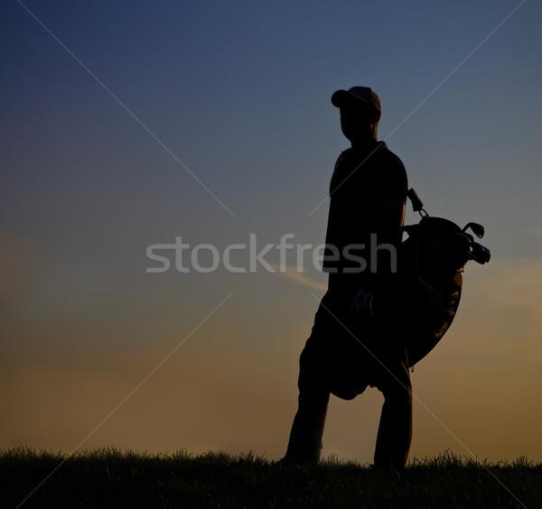 Male golfer at sunset Stock photo © dashapetrenko