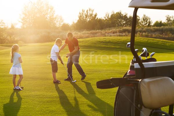 enfants golf domaine clubs de golf photo stock. Black Bedroom Furniture Sets. Home Design Ideas