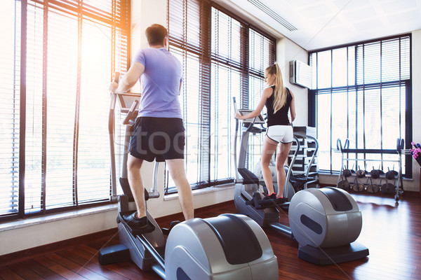 Couple training on a treadmill in a sport center Stock photo © dashapetrenko