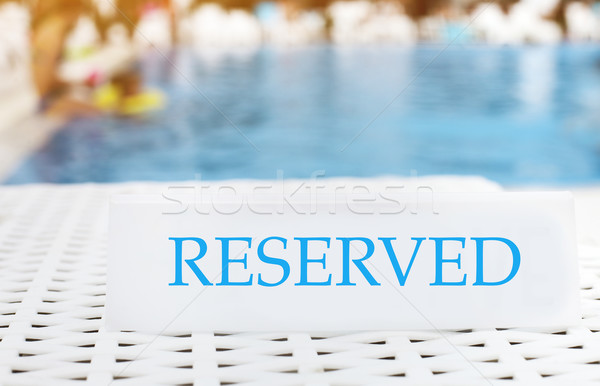 Reserved sign on the summer pool background Stock photo © dashapetrenko