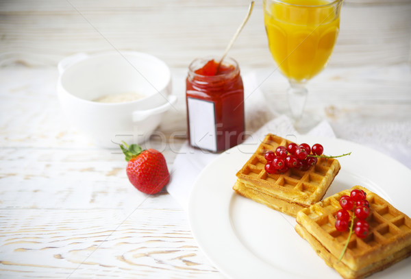 Waffles with red currant jam, orange juice and oat flakes oatmea Stock photo © dashapetrenko