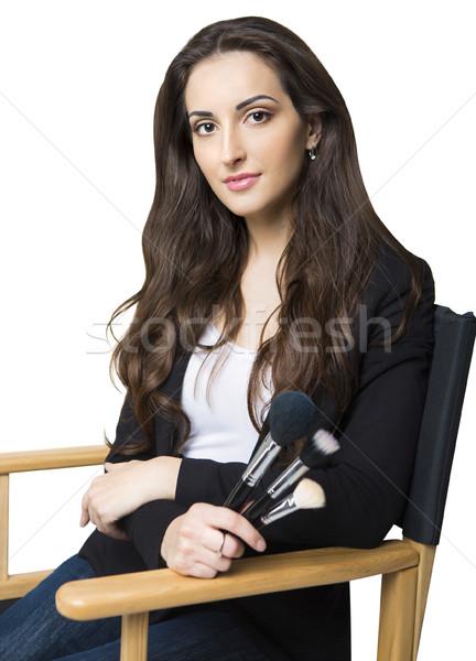 Young make-up artist isolated on white background Stock photo © dashapetrenko