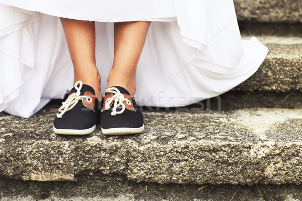 Stock photo: Funny beautiful bride wearing blue running shoes