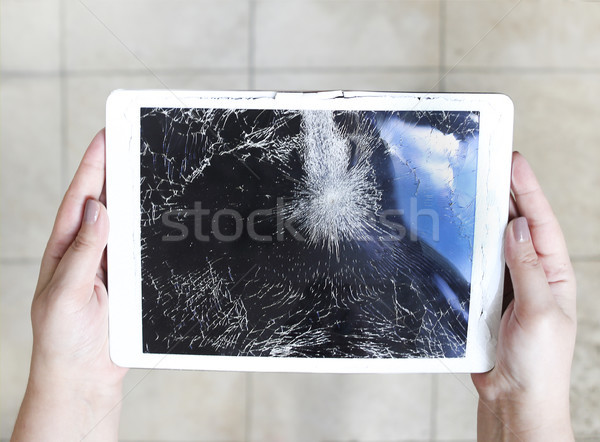Damaged tablet computer lcd display on the floor Stock photo © dashapetrenko