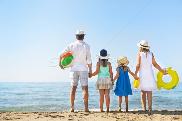 Portrait of a family with two children at beach. Holiday and tra Stock photo © dashapetrenko