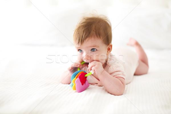 Seis mes bebé jugando cama caucásico Foto stock © dashapetrenko