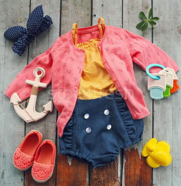Baby girl accessories on turquoise background Stock photo © dashapetrenko