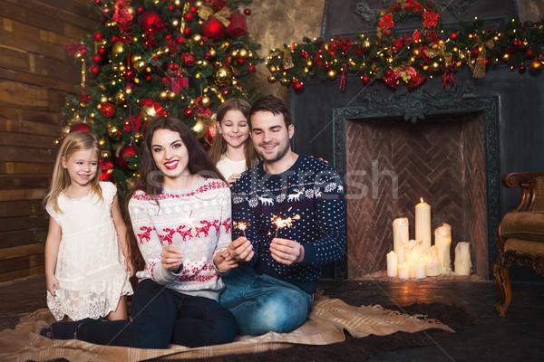 Happy family with sparklers celebrating Christmas Stock photo © dashapetrenko