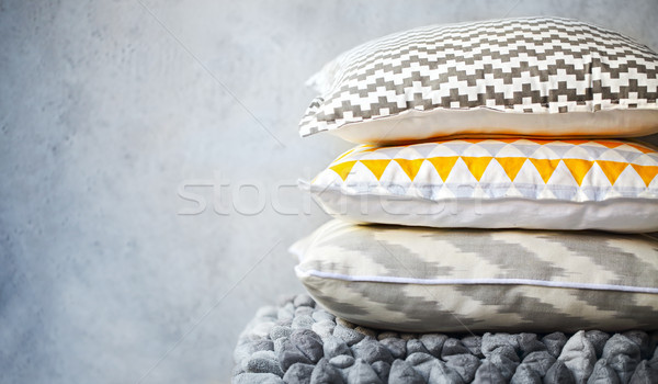 Yellow and grey pillows on the wall background Stock photo © dashapetrenko