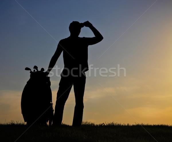 Maschio golfista tramonto giocare golf uomo Foto d'archivio © dashapetrenko