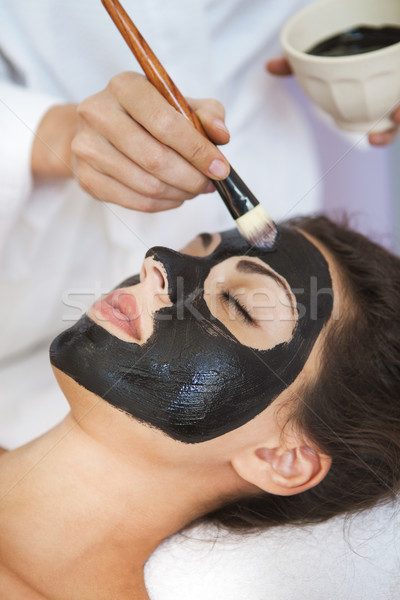 Young beautiful woman in a mask for the face of the therapeutic  Stock photo © dashapetrenko