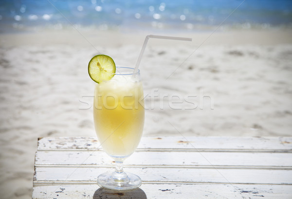 Tropical cocktail with rum on beautiful sunny beach Stock photo © dashapetrenko
