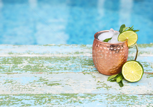 Natural homemade lemonade in cooper mug on rustic wooden backgro Stock photo © dashapetrenko