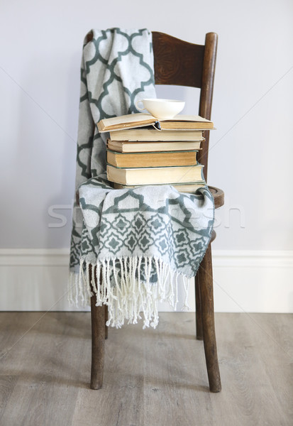Cup of coffee and books on the wooden chair Stock photo © dashapetrenko