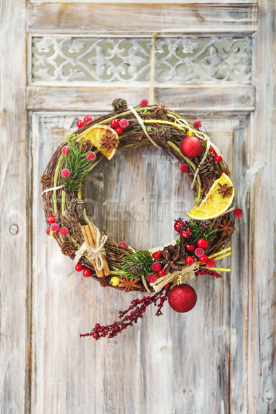 Christmas wreath on wooden door Stock photo © dashapetrenko