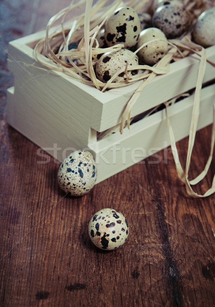 Stock photo: Spotted eggs on wooden background