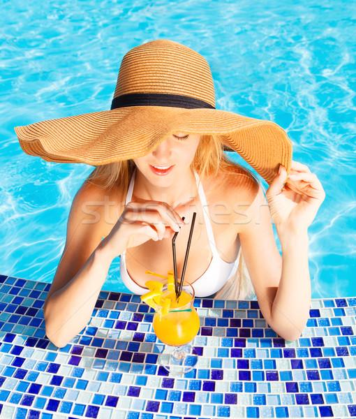 Pretty blond woman enjoying cocktail in a swimming pool Stock photo © dashapetrenko