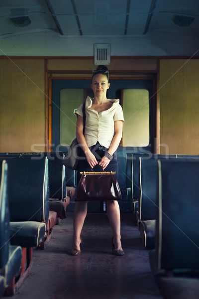 Woman with a suitcase walking in wagon of the retro train Stock photo © dashapetrenko