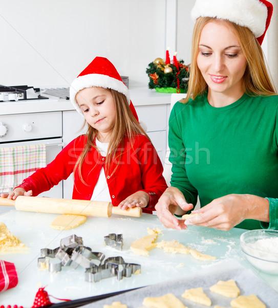 Adorable girl with her mother baking Christmas cookies Stock photo © dashapetrenko