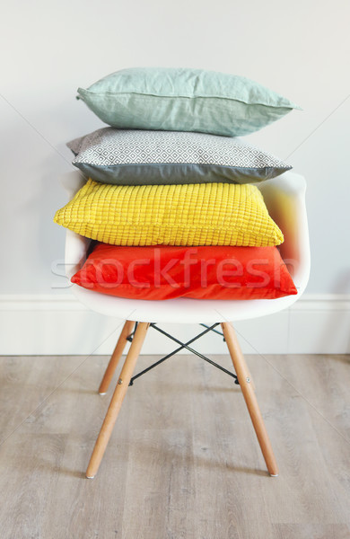 Chair in an interior with pillows in trendy colors Stock photo © dashapetrenko