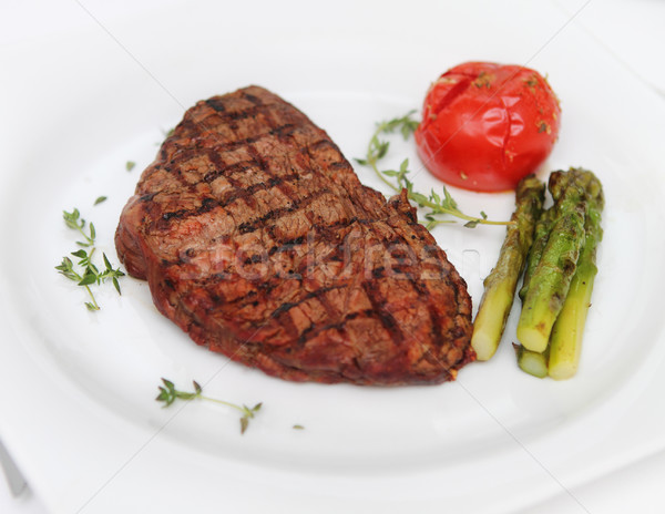 Beef steak with cooked asparagus Stock photo © dashapetrenko