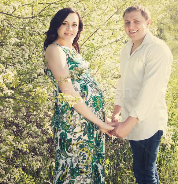 Genç mutlu hamile çift çiçekli bahar Stok fotoğraf © dashapetrenko