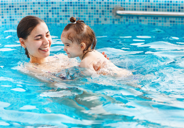 One year baby girl at her first swimming lesson with mother  Stock photo © dashapetrenko