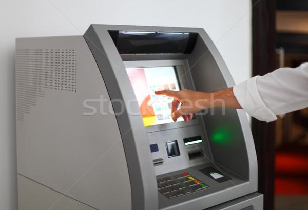 Man using banking machine Stock photo © dashapetrenko