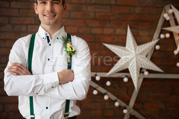 Groom wearing buttonhole with white anemone Stock photo © dashapetrenko