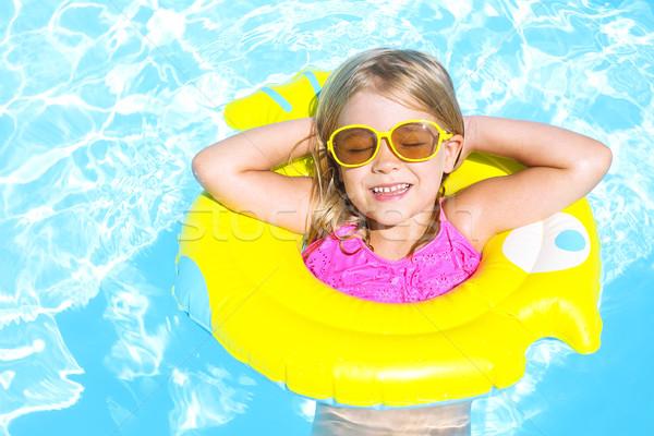 Happy child in swimming pool. Summer vacation  Stock photo © dashapetrenko