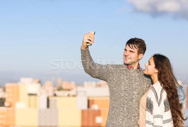 Young man and woman making selfie otdoors Stock photo © dashapetrenko