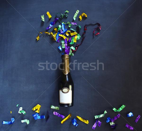 Pezsgő üveg fekete tarka konfetti buli Stock fotó © dashapetrenko