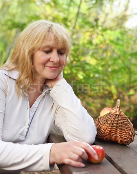 Middle aged woman outdoors Stock photo © dashapetrenko