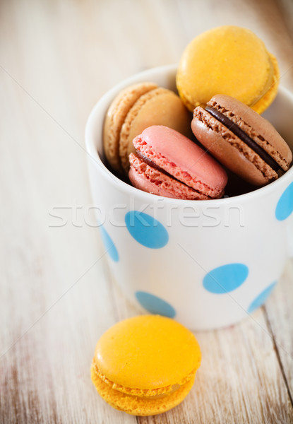 Stock photo: French macaroons in the cup