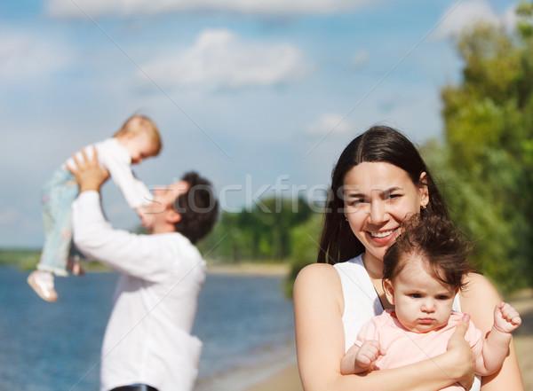 Feliz jovem família dois crianças rio Foto stock © dashapetrenko