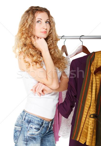 Portré lány kiválaszt ruházat bolt szőke Stock fotó © dashapetrenko