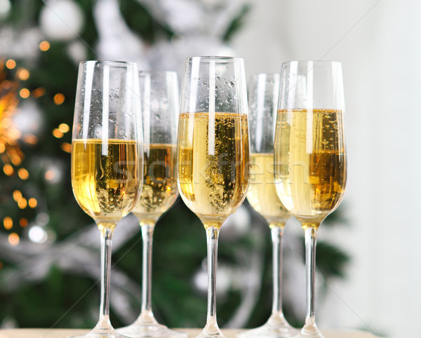Champagne near the Christmas tree Stock photo © dashapetrenko