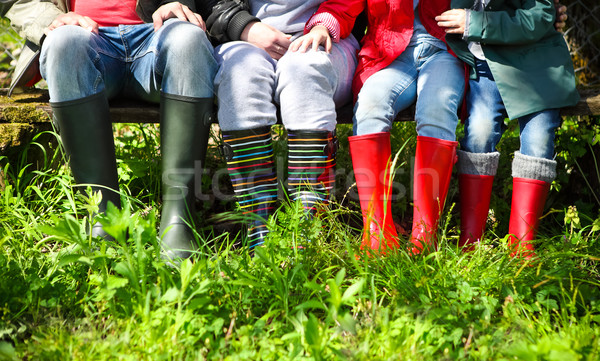 Happy family wearing colorful rain boots Stock photo © dashapetrenko