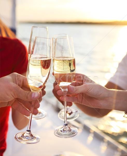 Boldog barátok szemüveg pezsgő jacht vakáció Stock fotó © dashapetrenko